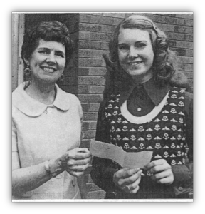 Margaret Bengtson (left) Chairwoman of the contest for high school girls congratulated Maureen McCormick
